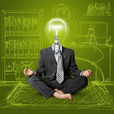 Lamp-head businessman in lotus pose Stock Photos