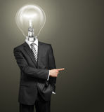 Lamp Head Businessman Showing With Finger Stock Photos