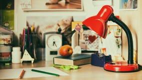 Lamp on schoolboy desk Stock Image