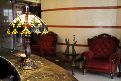 Lamp at hotel reception. Lamp and chairs at a boutique hotel reception Royalty Free Stock Photos