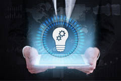 Lamp icon on virtual screen. Business solution. Innovation concept. Royalty Free Stock Photo