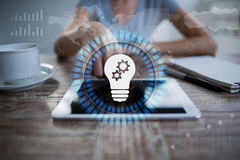 Lamp icon on virtual screen. Business solution. Innovation concept. Stock Photos