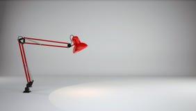 Lamp illuminates the floor in gray photo studio Stock Photography