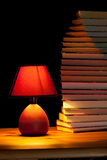 Lamp illuminating books Royalty Free Stock Photo
