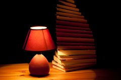 Lamp illuminating books Royalty Free Stock Image