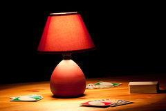 Lamp illuminating cards Royalty Free Stock Images