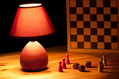 Lamp illuminating dice Stock Photos