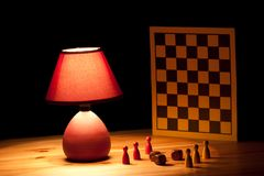 Lamp illuminating dice game Royalty Free Stock Photography