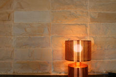 The lamp interior and stone wall. Detail of lamp interior and stone wall Royalty Free Stock Photos