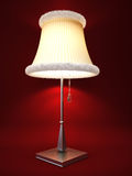Lamp isolated on red background Royalty Free Stock Photo