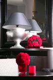 Lamp and its reflection in a mirror. Interior with a mirror, a lamp and red colors Stock Photos
