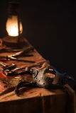 Lamp, knife and a mask on the table. On a gray background Royalty Free Stock Photo
