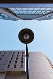 Lamp with lamppost and skyscraper Stock Photos