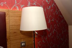 Lamp on nightstand Stock Images