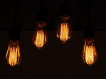 Lamp Light orange glow. Light orange glow of four lamp,black background Stock Photography