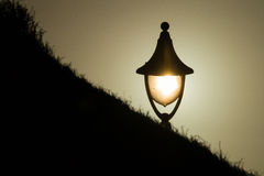 Lamp light at sunset. Lamp at sunset lit with the sun behind the glass Royalty Free Stock Photo