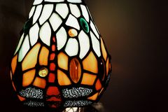 Lamp light textured multicolors textured indoors glass. Lamp light close-up textured art glass crystal indoors Stock Image