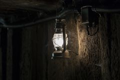 Lamp in mine. Old lamp in dark mine royalty free stock image
