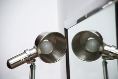 Lamp and mirror. Over white background Stock Image
