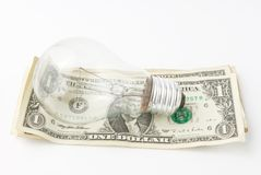 Lamp on money background Stock Photos