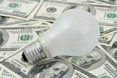 Lamp on money background royalty free stock photo