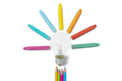 Lamp and multicolored crayon Stock Images
