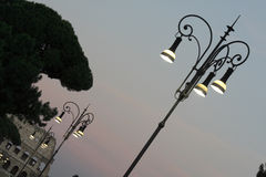 Street light near colosseum in Rome Italy. Street light near colosseum at sunset in Rome Italy Royalty Free Stock Image