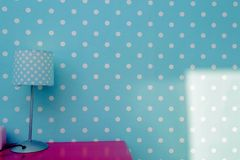 Lamp night light with blue wall and white dots wallpaper, colorful room for child modern design pink table. stock photos
