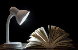 Lamp night light on the book. For reading. In library. Stock Photo