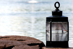 Lamp on the ocean. At dusk royalty free stock images