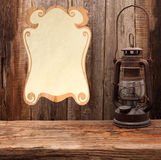 Lamp oil lantern certificate old wooden table Royalty Free Stock Images