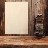 Lamp oil lantern paper blank old wooden Stock Images