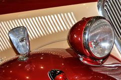 Lamp on old style car. Part of an old style car, with head lamp, which color and shape is beautiful, shown fantastic design and car manufacturing tecnology Royalty Free Stock Photos