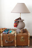 Lamp and old suitcase on the floor Stock Images