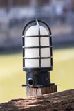 Lamp on the old wooden fence Royalty Free Stock Photography
