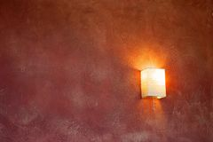 Lamp On A Claret Wall. Stock Photos