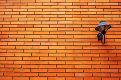 Lamp on orange brick wall. On home Stock Images