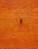 Lamp on orange brick wall. On home Royalty Free Stock Photography