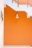 Lamp & orange wall royalty free stock photos