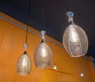 Lamp on orange wall Stock Images