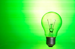 Lamp over green background Royalty Free Stock Photo