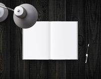 Lamp, pen and notebook Stock Image