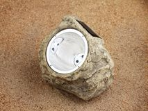 Lamp with photocell on the sand Royalty Free Stock Photo