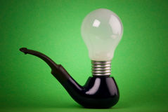 Lamp and pipe. Lamp on the smoking pipe Stock Photography