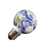A lamp the planet Earth. Planet Earth on a pedestal like energy save lamp isolated on white background. Eco Energy concept Royalty Free Stock Image