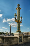 Lamp pole and obelisk. Paris Stock Photography
