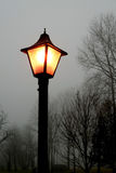 Lamp post. On foggy day early morning Stock Photos