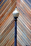 Lamp Post. A street lamp against a patterned background Stock Photos