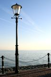 Lamp post along the waterside Royalty Free Stock Photos