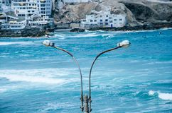 Lamp post on the beach stock photography